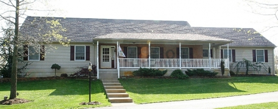 Ranch style house with front porch